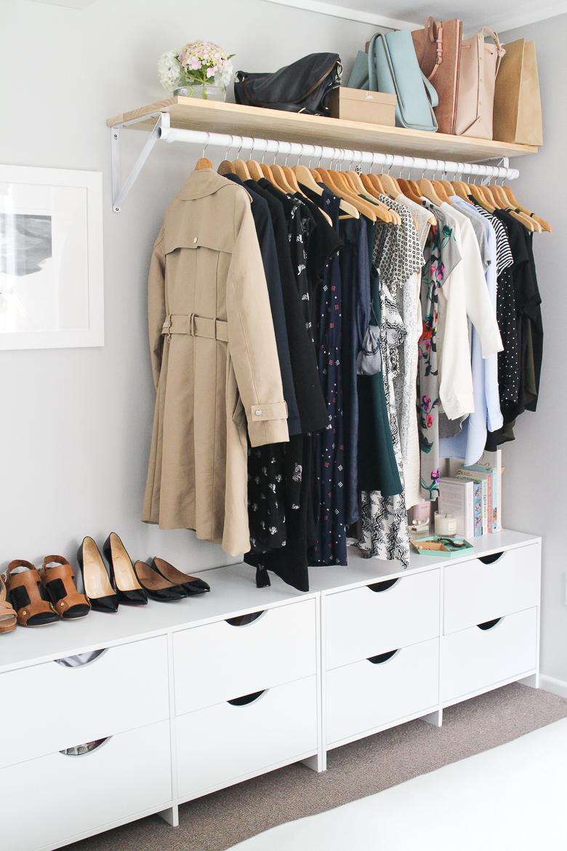 open wardrobe cupboard hanging rails.jpg
